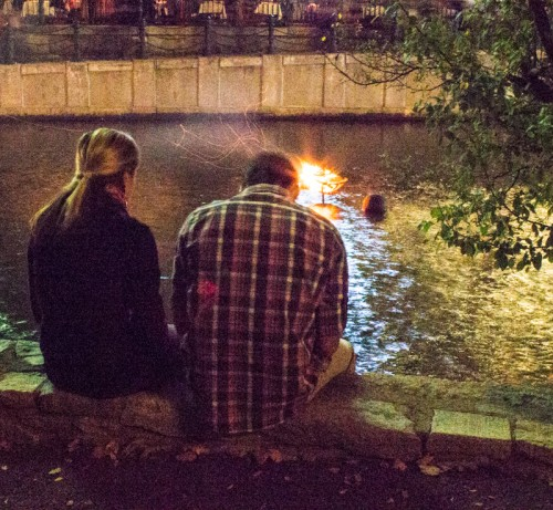 Couples sit along the quieter sections to watch the fires.