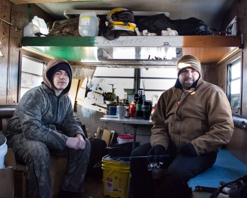 These two men invited me in to show me the inside of their bob-house (the converted trailer with the flag) and to get warm.  It was most welcome.